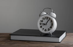 Alarm clock and book Royalty Free Stock Photos