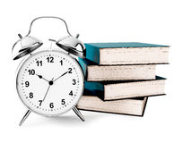 Alarm clock with books Stock Photos