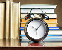 Alarm clock and books. Education concept Royalty Free Stock Images