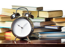 Alarm clock and books Royalty Free Stock Images