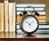 Alarm clock and books Royalty Free Stock Photos
