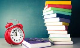 Alarm clock and books Stock Photo