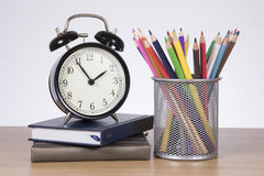 Alarm clock, books and school stationary supplies Stock Photography