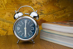 Alarm clock with books Stock Photo