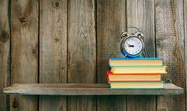 Alarm clock and books. Royalty Free Stock Photos