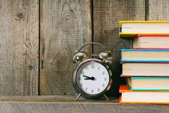 Alarm clock and books. Stock Photos