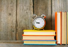 Alarm clock and books. Stock Photo