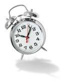 Alarm clock bouncing royalty free stock photography