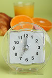 Alarm clock and breakfast Stock Image
