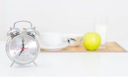 Alarm clock and breakfast. Stock Photos