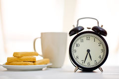Alarm clock and breakfast Royalty Free Stock Images
