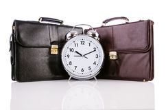 Alarm clock and briefcase Stock Photos