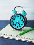 Alarm clock and businessman`s accessories Stock Images