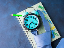 Alarm clock and businessman`s accessories Stock Photography