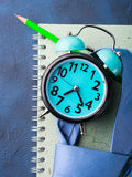 Alarm clock and businessman`s accessories Stock Photos