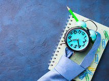 Alarm clock and businessman`s accessories Royalty Free Stock Images