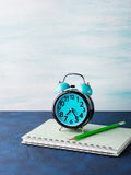Alarm clock and businessman`s accessories Stock Image