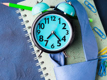 Alarm clock and businessman`s accessories Royalty Free Stock Image