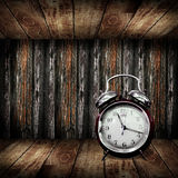 Alarm clock in cabinet Royalty Free Stock Images