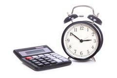 Alarm clock and calculator royalty free stock photos