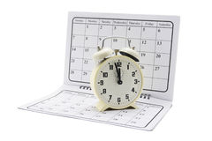 Alarm Clock on Calendar Stock Photography