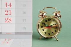 Alarm clock and calendar Stock Images