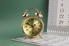 Alarm clock and calendar Royalty Free Stock Photo