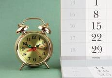 Alarm clock and calendar Stock Photo