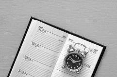 Alarm clock on calendar Royalty Free Stock Images