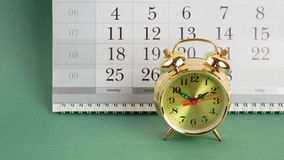 Alarm clock and calendar Stock Photos