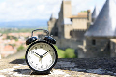 Alarm clock and the castle Royalty Free Stock Photography