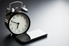 Alarm clock with cellphone Stock Image
