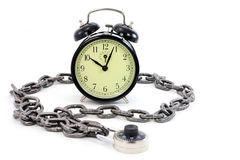 Alarm clock and chain Stock Photo