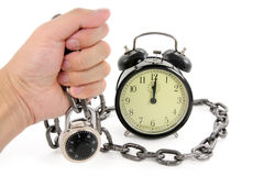 Alarm clock and chain Royalty Free Stock Photography