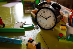 Alarm clock on child desktop Stock Images