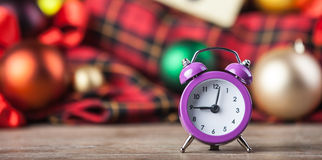 Alarm clock and christmas gifts Royalty Free Stock Images