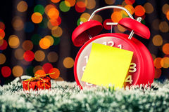 Alarm clock with christmas lights Royalty Free Stock Photography