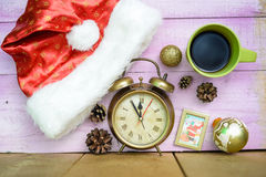 Alarm clock with Christmas ornaments beside Santa stock photography