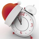 Alarm clock with christmas santa hat Stock Image