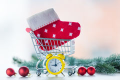 Alarm clock and christmas sock Royalty Free Stock Images