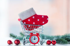 Alarm clock and christmas sock Stock Images
