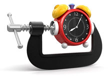 Alarm Clock in clamp (clipping path included) Royalty Free Stock Photography