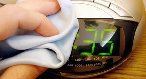 Alarm clock cleaning Stock Image