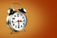 Alarm clock with clipping path. Space for writing text on a dark background shot clock used Royalty Free Stock Photography