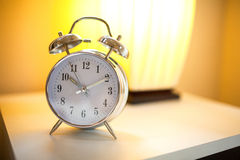 Alarm clock. Close up view of alarm-clock in morning bedroom environment Stock Image