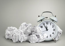 Alarm clock and clumpled peper, waste of time concept. Clock and clumpled peper, waste of time concept stock photography