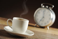 Alarm clock and coffee. Cup royalty free stock photo