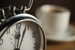 Alarm clock and coffee. Cup stock photography