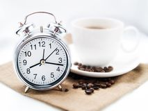 Alarm clock and coffee cup Royalty Free Stock Photo