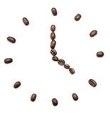 alarm clock of coffee grains royalty free stock photo